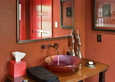 Dyed walnut powder room vanity;