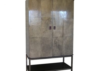 Parchment armoire with bronze base